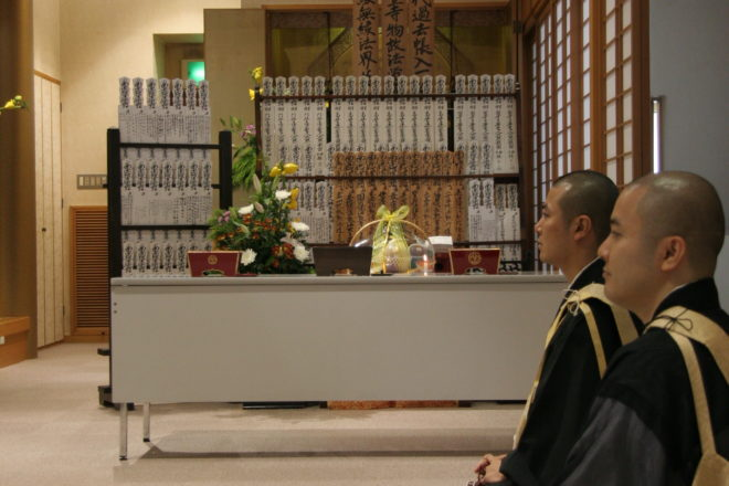 Priests listening to a sermon during the Higan ceremony