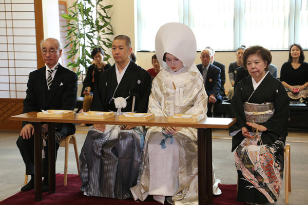"""Waiting for the priest's final speech. People sitting beside us are our """"Nakōdō"""" – usually translated as matchmakers but they actually take care of young couple in many ways."""